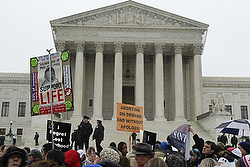 People gather outside the U.S. Supreme Court during the annual March for Life in Washington Jan. 23. The annual pro-life demonstration marks the 1973 Supreme Court decision that legalized abortion across the nation. (CNS photo/Bob Roller)