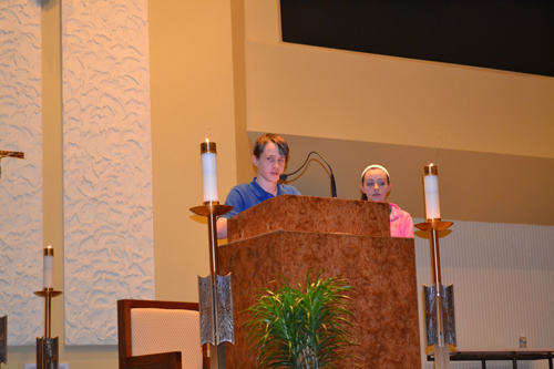 Mark Meyer, left, of St. Xavier High School, shared his thoughts as a student witness at the event.