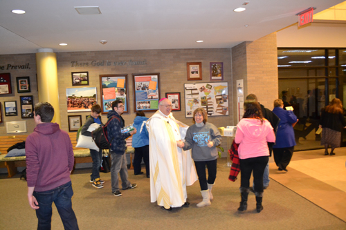 Bishop Joseph R. Binzer greets participants about to embark on a trip to Washington D.C. for the March for Life