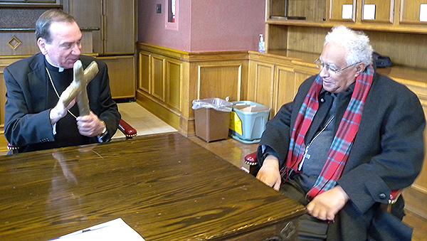Archbishop Dennis M. Schnurr and Bishop Macram Max Gassis sit and talk