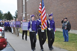 The Elder Honor Guard, and others process with 12 shadow boxes honoring those from Elder who died in Vietnam. (Courtesy Photo)