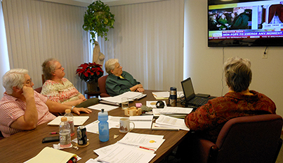 Sisters of the Precious Blood at the Congregation's administrative offices in Dayton watch news coverage of the announcement of a new pope on March 13. From left, Sisters Mary Yarger, Linda Pleiman, Nancy McMullen and Nancy Kinross. (Courtesy Photo)