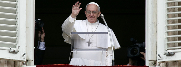 Newly elected Pope Francis waves to crowd during Angelus at Vatican