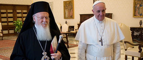 Pope Francis walks with Ecumenical Patriarch Bartholomew of Constantinople at Vatican