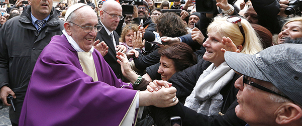 Pope Francis greets people after celebrating Mass at St. Anne's Parish within Vatican