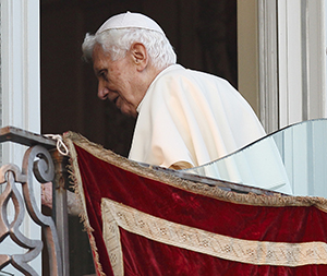 Pope Benedict XVI walks away after making final public appearance as pope.