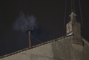 Black smoke billows from the chimney of the Sistine Chapel