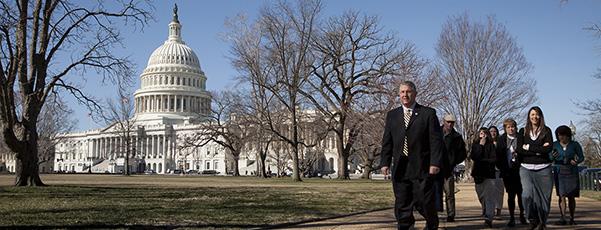 People walk near U.S. Capitol in Washington