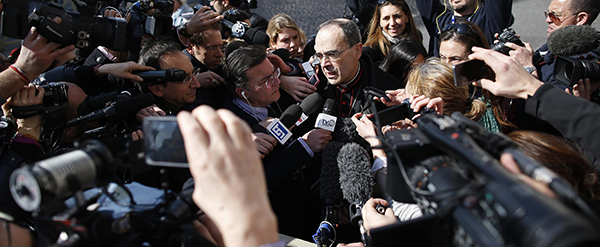 French Cardinal Barbarin talks to reporters at the end of a meeting at the Vatican