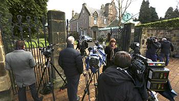 Members of media gather outside residence of Cardinal O'Brien in Edinburgh, Scotland