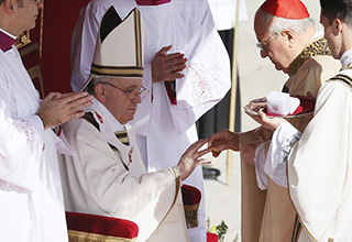 Pope Francis receives ring during inaugural Mass in St. Peter's Square at Vatican