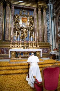 Newly elected Pope Francis prays in front of icon at Rome basilica