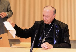 Belgian archbishop reacts after activist threw water on him during debate at university in Brussels