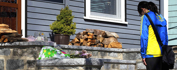 Boston Marathon runner leaves flowers on doorstep of home of 8-year-old Martin Richard, who was killed in blast
