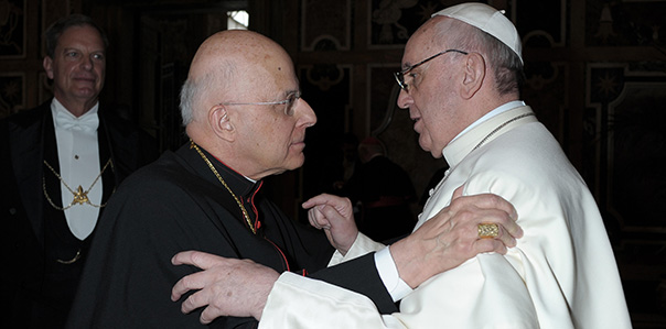 U.S. Cardinal George greets Pope Francis during March 15 audience