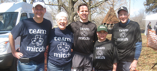 St. Antoninus Principal Jack Corey, center, poses with fellow members of Team Mitch. From left are Sean McHale, a cousin from Baltimore, Jack Corey's mother Mary, Corey, his son Joseph, and his father Bill.