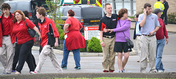 La Salle High School students leave school with their parents Monday morning in the aftermath of an in-school suicide attempt by a student. (CT Photo/John Stegeman)