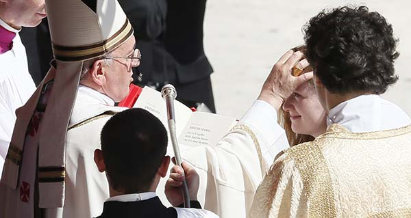 Pope administers sacrament of confirmation to U.S. teen during Mass at Vatican