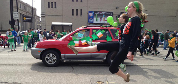 Members of the Erickson Academy of Irish Dance leap throughout the streets of Cincinnati in the 2013 St Patrick's Day Parade.