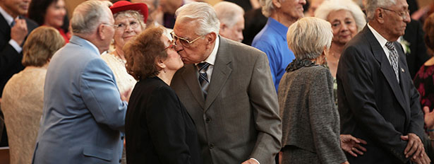 COUPLE KISSES AFTER RENEWING MARRIAGE VOWS AT LOS ANGELES CATHEDRAL
