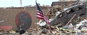 U.S. flag stands near destroyed car outside Oklahoma elementary school destroyed in massive tornado