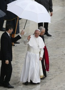 Pope waves after celebrating Mass for members of confraternities in St. Peter's Square