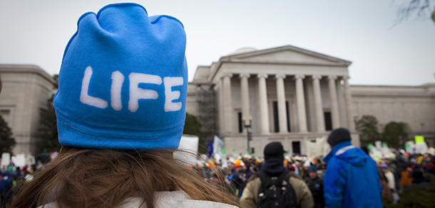 Minnesota woman stands in front of Supreme Court building during March for Life in Washington