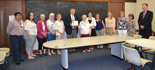 Mike Gable of the Archdiocese of Cincinnati mission office, center, and the staff and volunteers of the Su Casa Hispanic Center pose for a photo after the Spirit of Sister Dorothy Stang Award presentation. (CT PHOTO/John Stegeman)