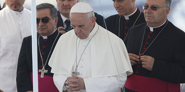 Pope Francis prays after tossing a wreath into the Mediterranean Sea off the Italian island of Lampedusa July 8.  (CNS photo/Paul Haring)