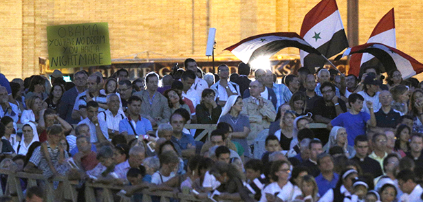"Syrian flags are seen near a sign saying ""Obama you have no dream, you have a nightmare,"" as Pope Francis leads a vigil to pray for peace in Syria in St. Peter's Square at the Vatican Sept. 7. (CNS photo/Paul Haring) (Sept. 10, 2013) See POPE-SYRIA (UPDATED) Sept. 9, 2013 and PRAYER-SYRIA Sept. 7, 2013."