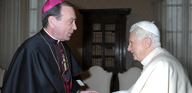 "Pope Benedict XVI greets Archbishop Dennis M. Schnurr of Cincinnati during a Feb. 2 meeting with U.S. bishops on their ""ad limina"" visits to the Vatican."