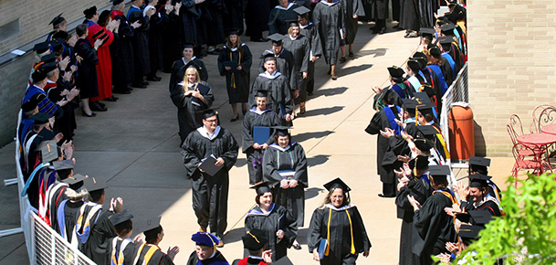 Graduates march during the 2007 graduation ceremonies at the College of Mount St. Joseph. The Mount will become Mount St. Joseph University in July of 2014. (CT FILE PHOTO)