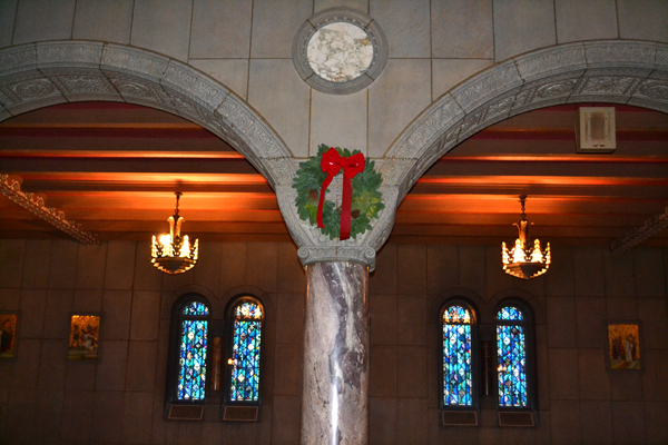 A wreath colors the walls of St. Louis Church in downtown Cincinnati. (CT Photo/John Stegeman)