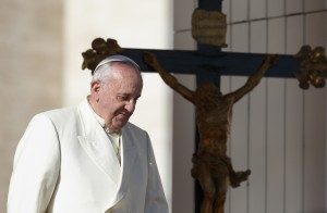 Pope Francis passes a crucifix as he walks down steps during his general audience in St. Peter's Square at the Vatican Dec. 4. (CNS photo/Paul Haring) (Dec. 4, 2013) See POPE-AUDIENCE Dec. 4, 2013.