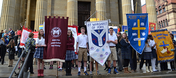 Students pose with their school banners outside the Cathedral of St. Peter in Chains following the 2013 Catholic Schools Week Cincinnati Mass. The 2014 Mass, scheduled for Tuesday Jan. 28 has been cancelled as a result of extreme cold temperatures. (CT Photo/John Stegeman)