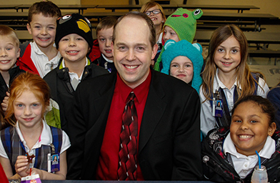 Jim Rigg, superintendent of Catholic Schools for the Archdiocese of Cincinnati poses with students in a 2013 file photo.