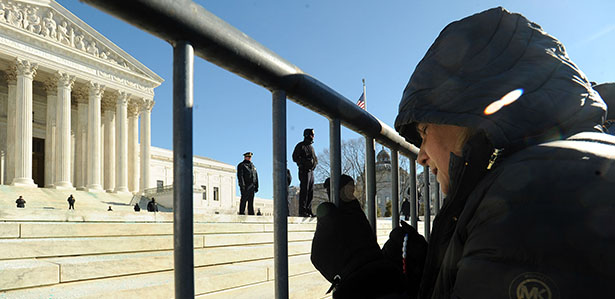 A woman prays outside the U.S. Supreme Court building during the March for Life in Washington Jan. 22. Thousands took part in the annual event, which this year marked the 41st anniversary of the Supreme Court's Roe v. Wade decision that legalized abortion across the nation. (CNS photo/Leslie Kossoff) (Jan. 22, 2014) See MARCH-SPEAKERS Jan. 22, 2014, and story to come.