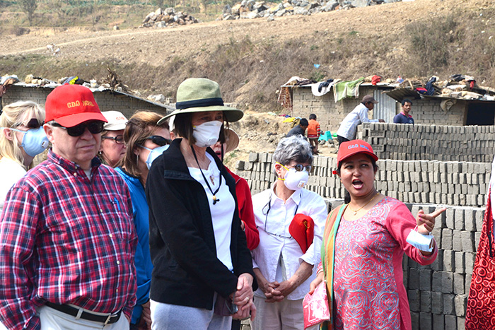 Founder of Care & Development Organization (CDO) Nepal, Arati Basnet takes the Archdiocese of Cincinnati group on a tour of the brick factory in Kathmandu, Nepal. (CT Photo/Megan Walsh)