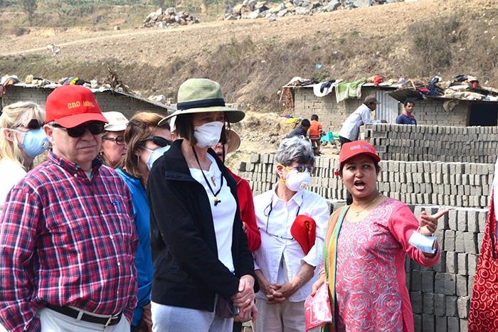 Founder of Care & Development Organization (CDO) Nepal, Arati Basnet takes the Archdiocese of Cincinnati group on a tour of the brick factory in Kathmandu, Nepal. (CT Photo/Megan Walsh)