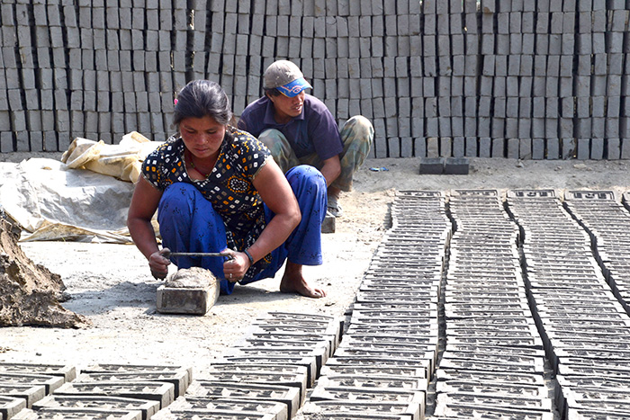 Brick factory workers labor for 12 to 14 hours to earn between $3 and $5 a day. (CT Photo/Megan Walsh)