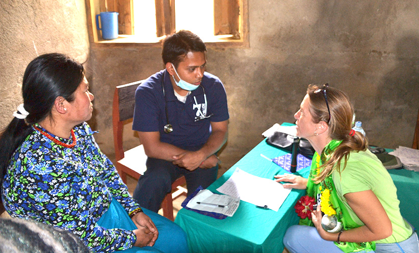 Pediatrician Gretchen Zima, from the Archdiocese of Cincinnati group, talks with a doctor about health in Nepal. (CT Photo/Megan Walsh)