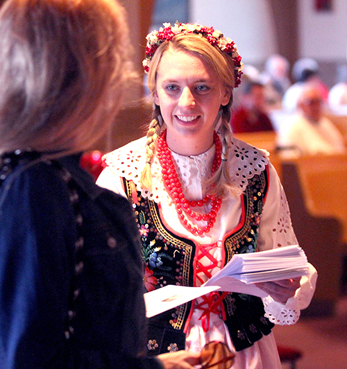 Anne Jagielski, in traditional Polish outfit, passes out programs for the special Mass at St. Adalbert Parish in Dayton Sunday, April 27, 2014, to celebrate the Canonizations of Pope John Paul II and Pope John XXIII. (CT Photo/E.L. Hubbard)