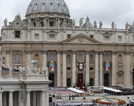 Pope Francis celebrates the canonization Mass for Sts. John XXIII and John Paul II in St. Peter's Square at the Vatican April 27. (CNS photo/Paul Haring) (April 27, 2014) See SAINTS-MASS and SAINTS-COLOR April 27, 2014.