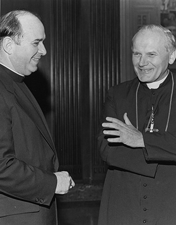 Cardinal Karol Wojtyla of Poland, is welcomed by then-Archbishop of Cincinnati Joseph L. Bernardin at St. Peter in Chains cathedral on Sept. 2, 1976. Cardinal Wojtyla visited Cincinnati to thank Archbishop Bernardin for his visit to Poland. (CT File Photo)