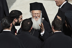 Ecumenical Patriarch Bartholomew, center, talks with delegates at the conclusion of Pope Francis' inaugural Mass in St. Peter's Square at the Vatican in this March 19, 2013, file photo. It was the first time an Orthodox patriarch had attended a papal inauguration since the East-West schism in 1054. Pope Francis will meet Patriarch Ecumenical Patriarch Bartholomew May 25 during his three-day visit to the Holy Land. (CNS photo/Vatican)