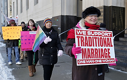 Woman carries sign opposed to same-sex marriage outside Federal Court House in Detroit