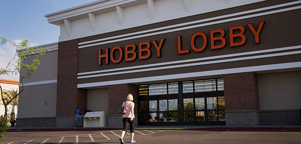 A woman walks toward a Hobby Lobby store in Phoenix March 24. The Hobby Lobby chain and Conestoga Wood Specialties are the plaintiffs in two cases before the Supreme Court. They are suing over a federal requirement that employers cover a range of contraceptives and services in their employees' health plans. The companies' Christian owners object to the mandate on religious rights grounds. (CNS photo/Nancy Wiechec) (March 24, 2014) See SCOTUS-MANDATE and MANDATE-PROTEST March 25, 2014.