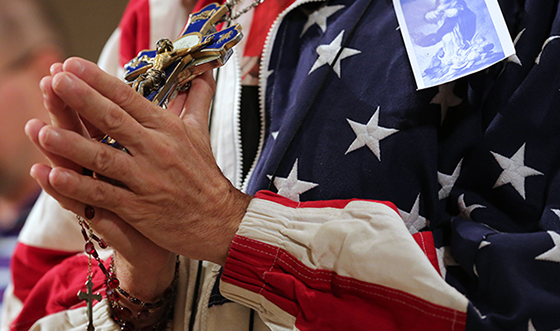 A worshipper holding a rosary and crucifix prays during a July 4 Mass celebrated at the Basilica of the National Shrine of the Immaculate Conception in Washington on the final day of the U.S. bishops' Fortnight for Freedom campaign. (CNS photo/Bob Roller) (July 4, 2014) See story to come.