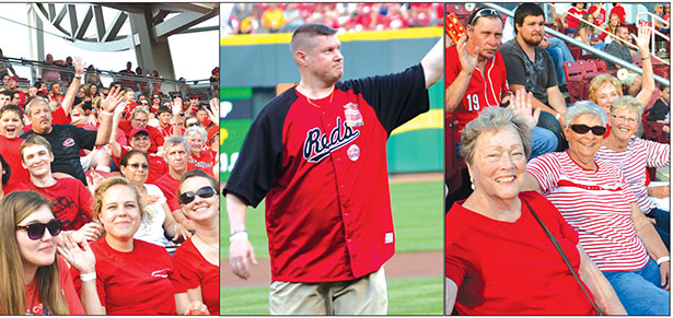 St. Ann parish brought a big crowd to a recent Cincinnati Reds' game and their pastor delivered the game ball. (CT Photos/John Stegeman)