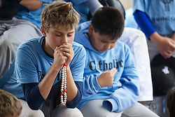 Campers pray the rosary July 24 during Mike Sweeney Catholic Baseball Camp at the Russell Road Sports Complex in Kent, Wash. (CNS photo/Stephen Brashear) See BASEBALL-CAMP July 30, 2014.